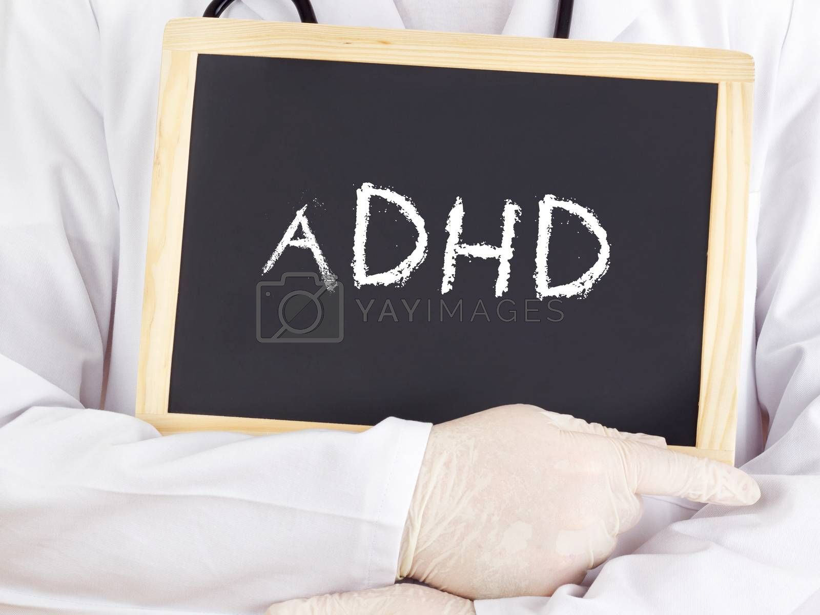 Royalty free image of Doctor shows information on blackboard: adhd by gwolters