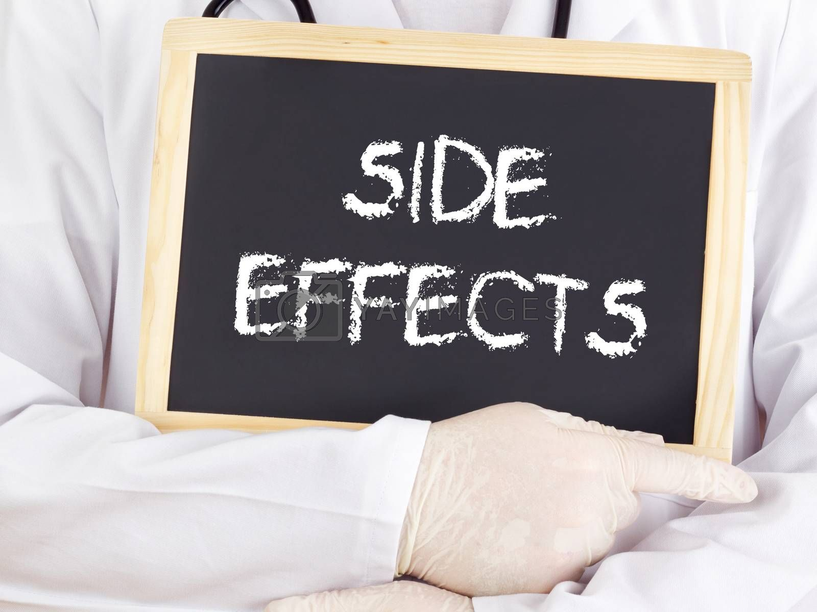 Royalty free image of Doctor shows information on blackboard: side effects by gwolters