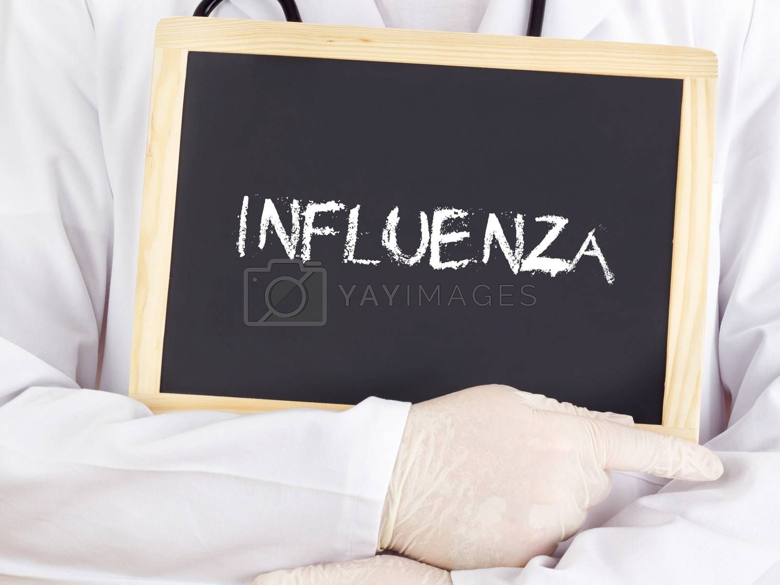 Royalty free image of Doctor shows information on blackboard: influenza by gwolters