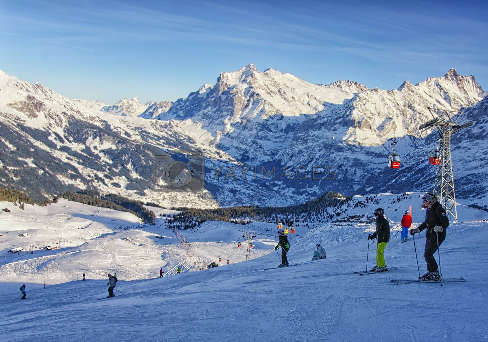 Royalty free image of Men and women on ski  and snowboards near cable railway on winte by erix200511@mail.ru