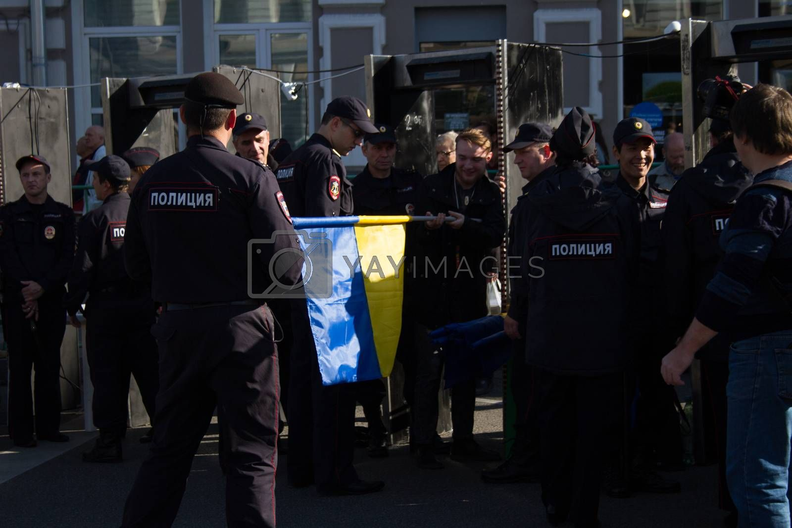 Moscow, Russia - September 21, 2014. Ukrainian flag checks the Russian police Peace March in Moscow against war with Ukraine