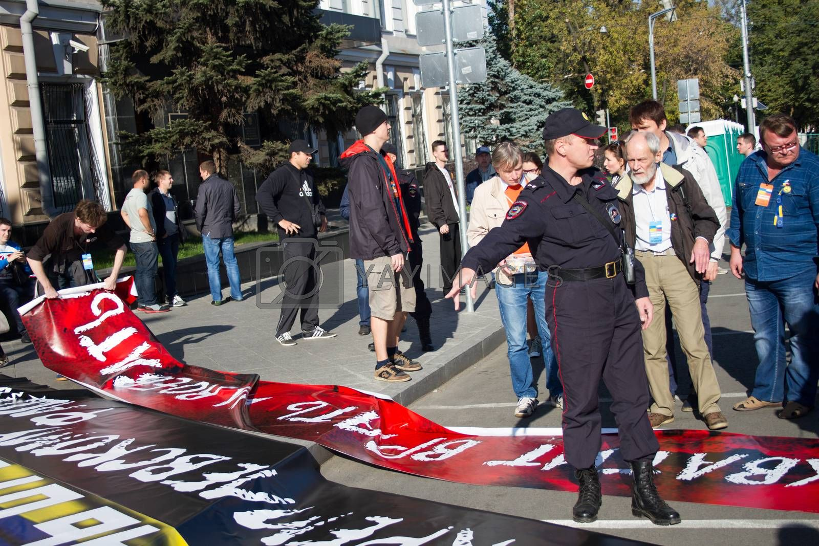 Royalty free image of Police confiscated some posters with peace March by olegkozyrev