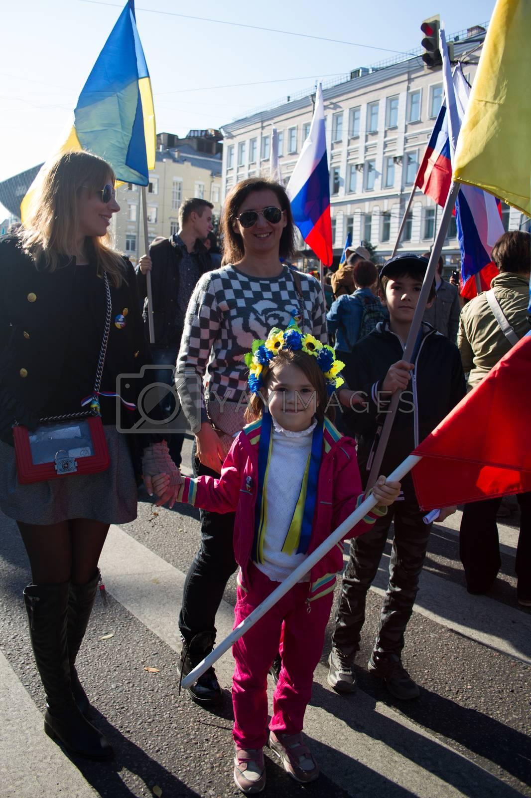 Royalty free image of little girl in the Ukrainian wreath by olegkozyrev