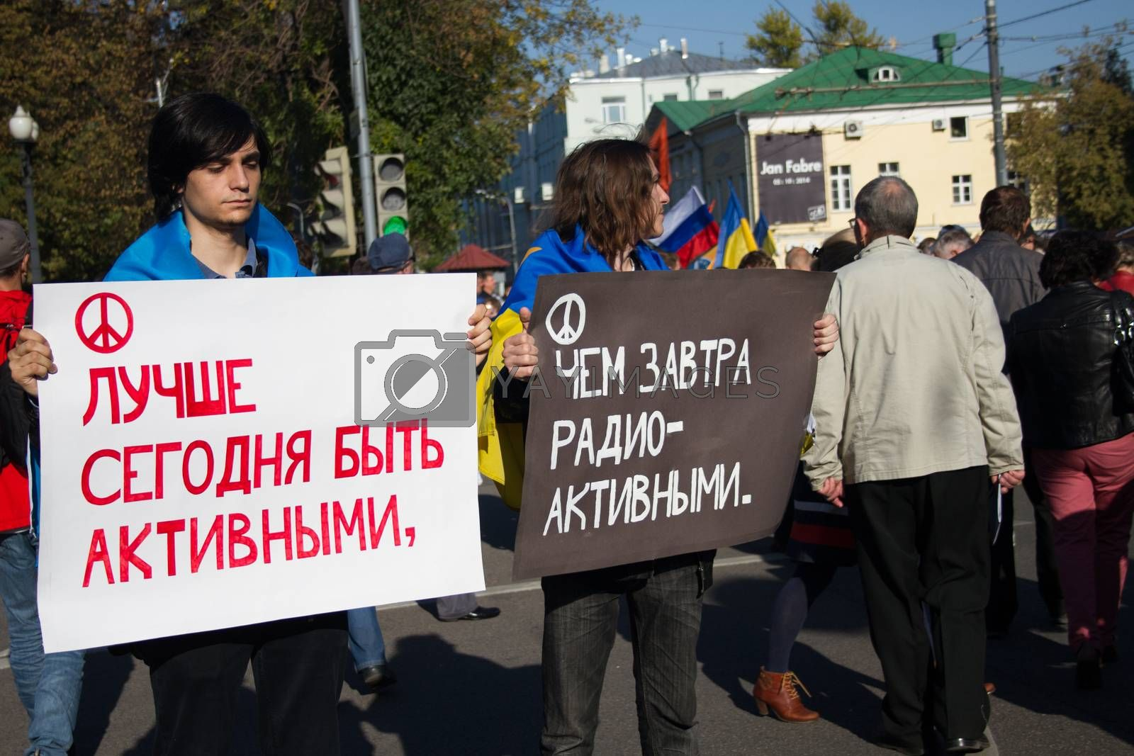 Moscow, Russia - September 21, 2014. Unknown opposition with posters - is better to be active today than tomorrow radioactive Peace March in Moscow against war with Ukraine