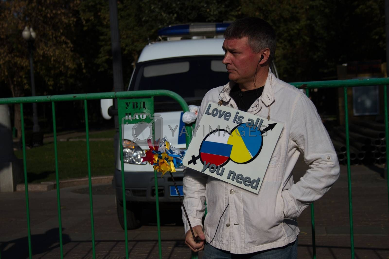 Moscow, Russia - September 21, 2014. Unknown opposition with the poster peace March Peace March in Moscow against war with Ukraine