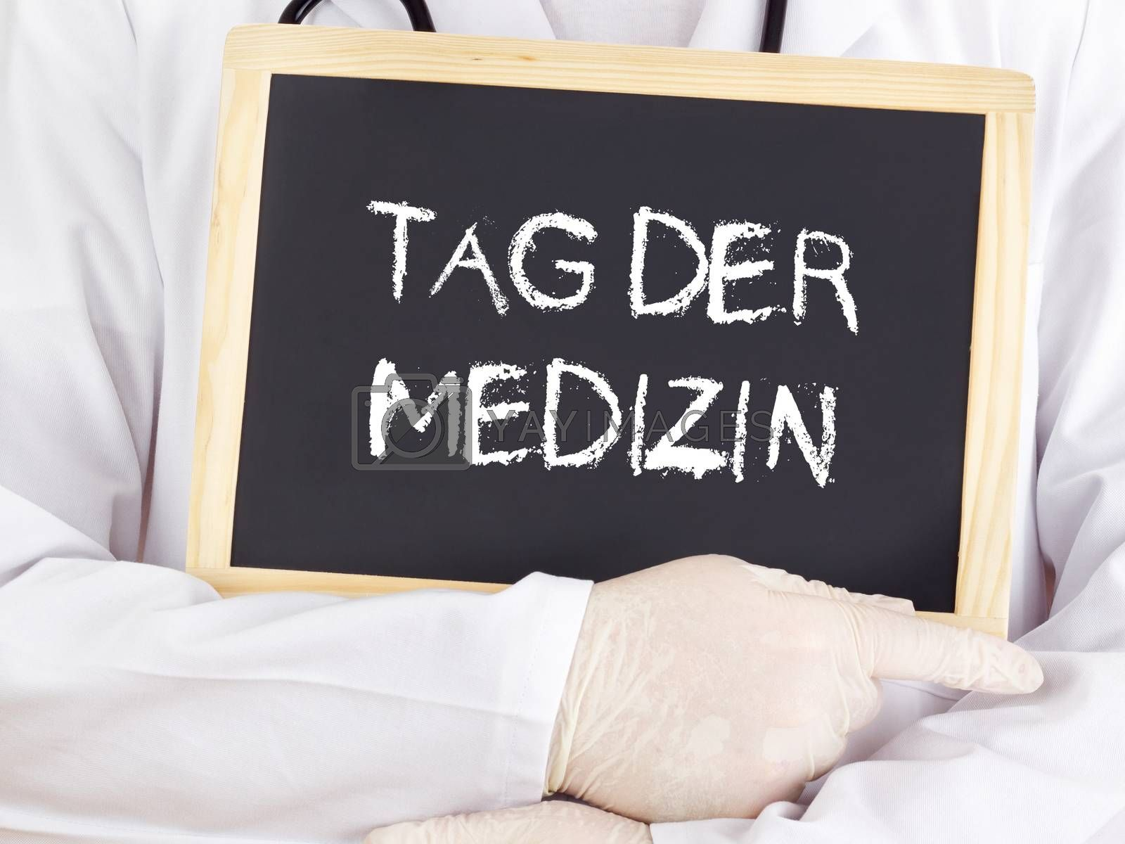 Royalty free image of Doctor shows information: Doctors Day in german language by gwolters