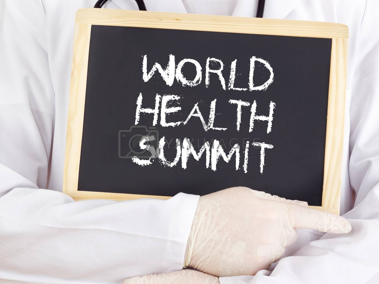 Royalty free image of Doctor shows information: World Health Summit by gwolters