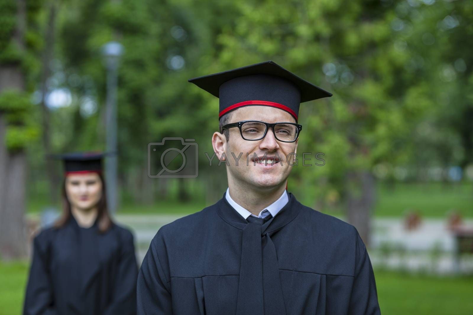 Outdoor portrait of a young student man in the graduation day.