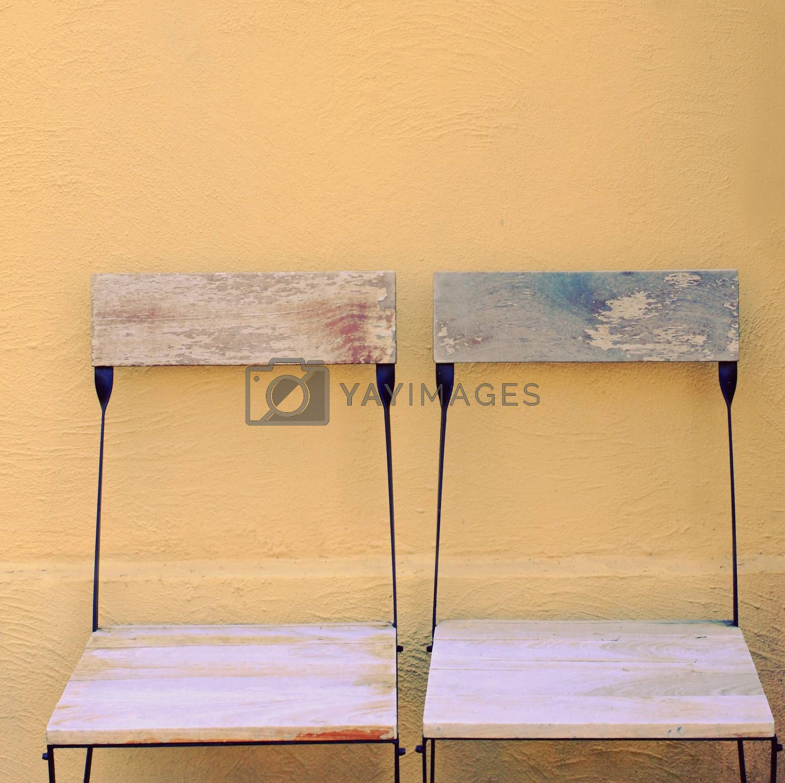 Outdoor wooden chairs with retro filter effect