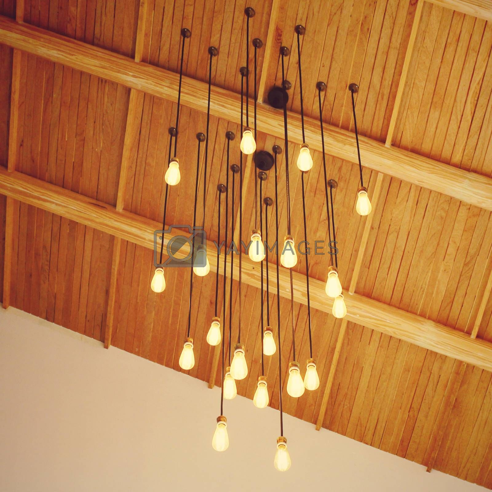 Vintage lighting decor hanging from ceiling with retro filter effect
