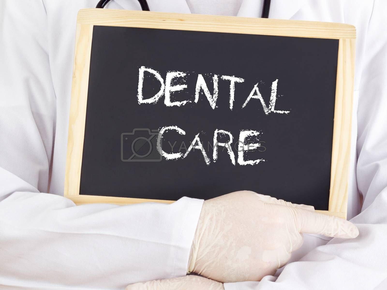 Royalty free image of Doctor shows information: dental care by gwolters