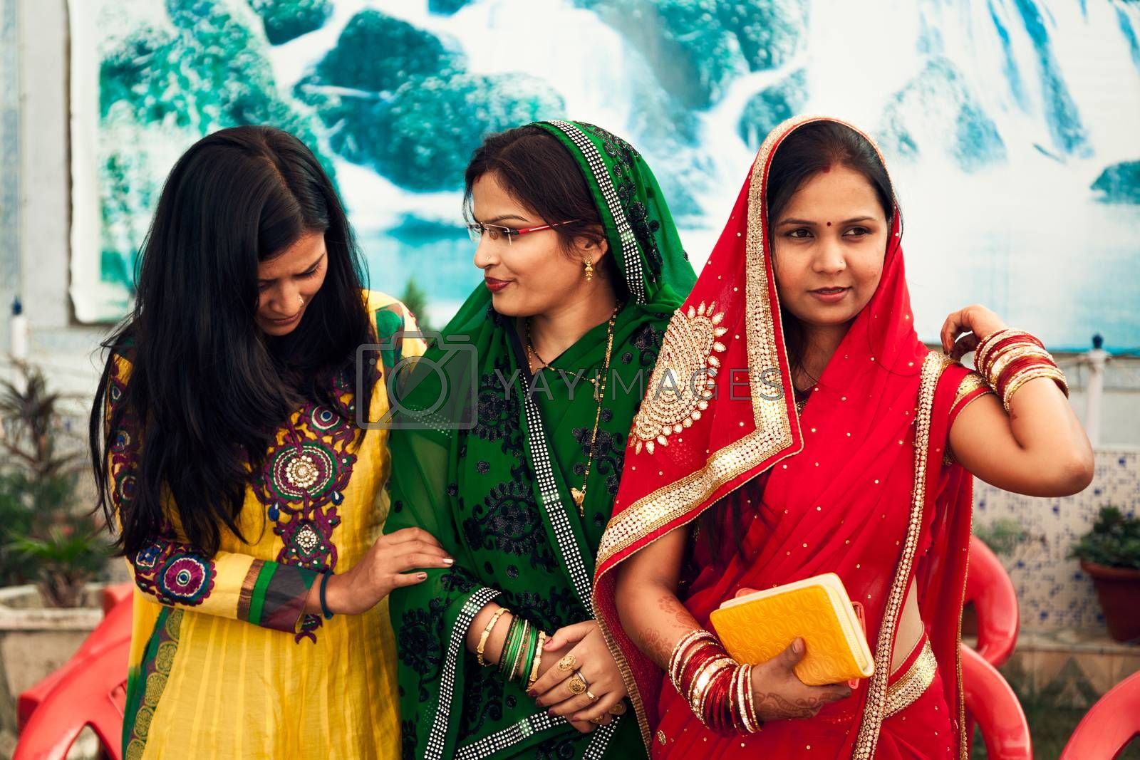 Happy Indian womens in Indian traditional dresses called colourful sarees and suit