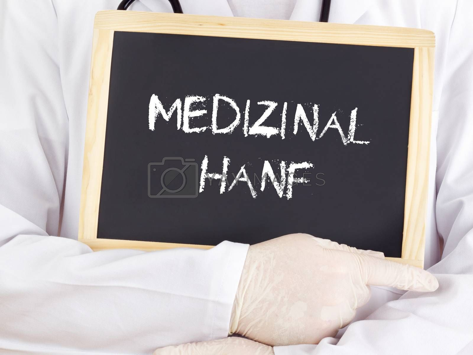 Doctor shows information on blackboard: medical marijuana in german by gwolters