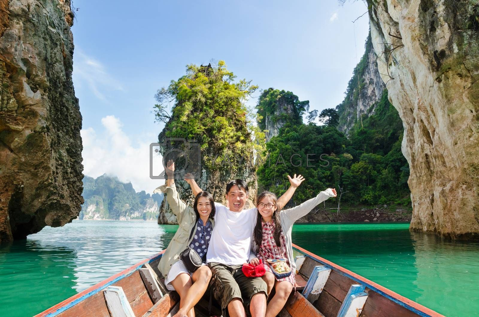 Happy family boat trip on summer vacation in Ratchaprapha Dam, Khao Sok National Park, Surat Thani Province, Thailand ( Guilin of Thailand )