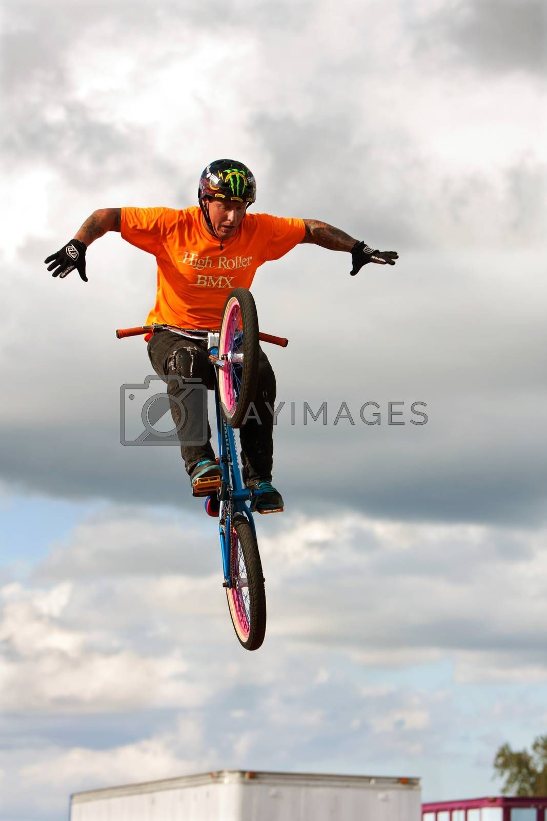 Hampton, GA, USA - September 27, 2014:  A young man with the High Roller BMX club takes his hands off the handlebars while performing a midair BMX stunt at the Georgia State Fair.