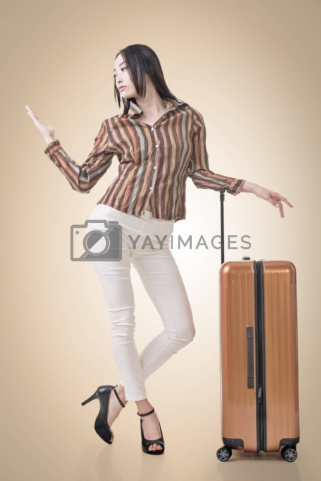 Modern Asian woman stand with a luggage in vintage style.
