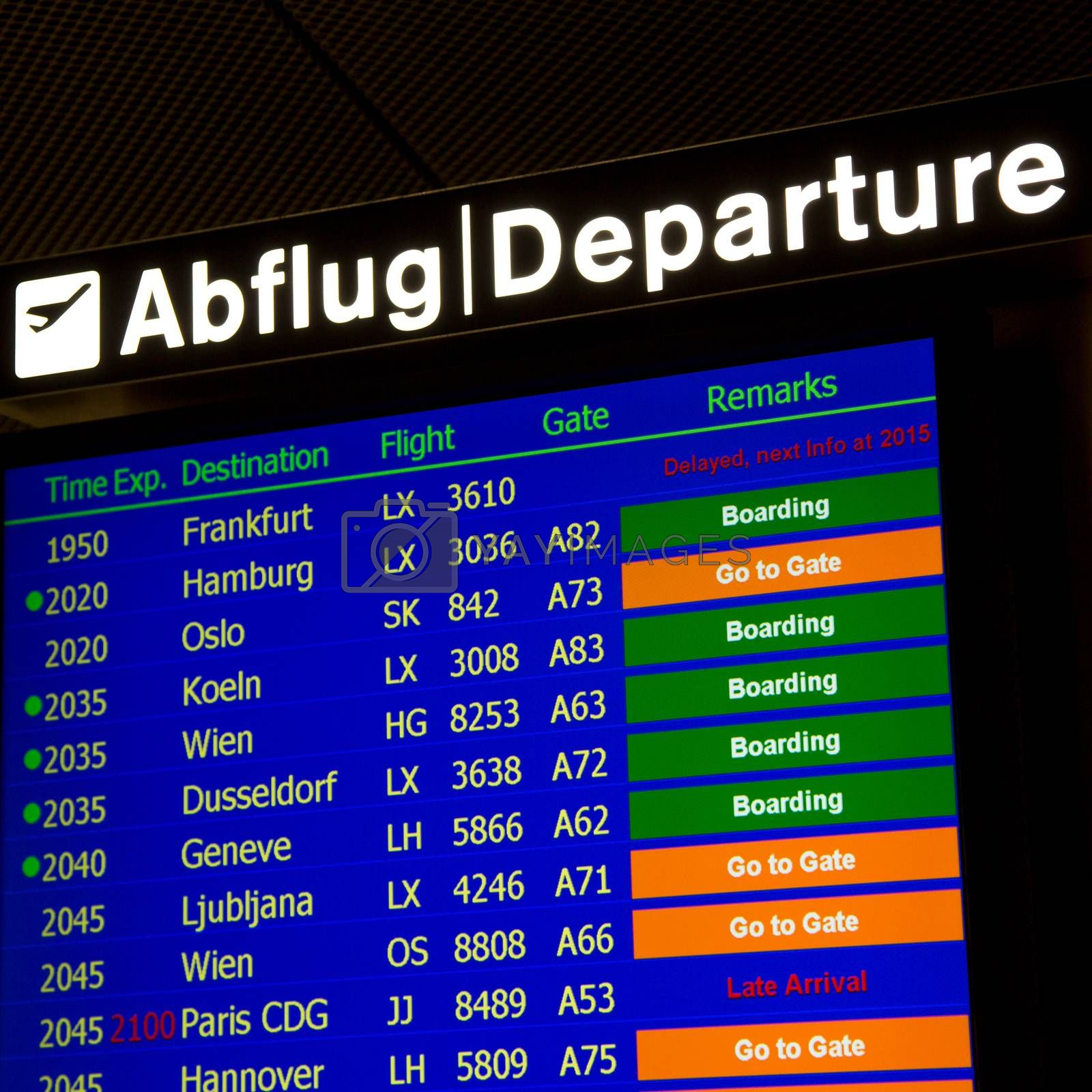 Airport departure board in terminal with flight information
