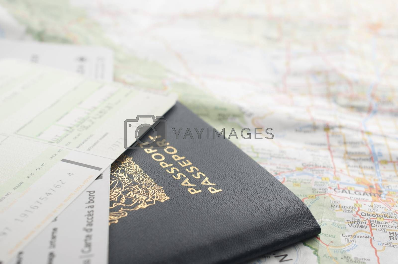 Carrying passport, board card and map ready to travel.