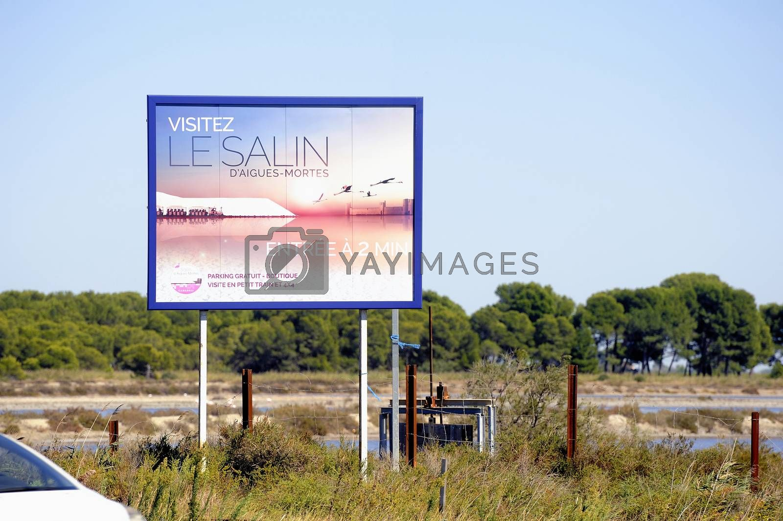 billboard saline Aigues-Mortes in Camargue to announce that tourists can visit the industrial enterprise.