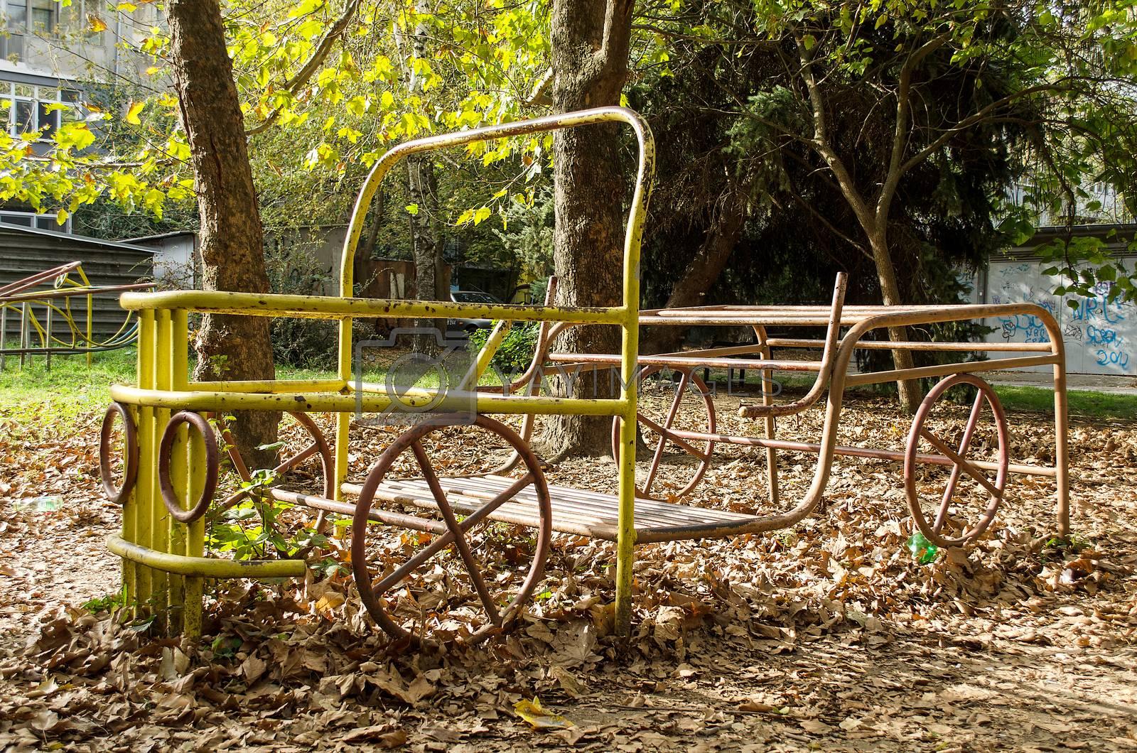 Playground  yellow truck retro spring close up