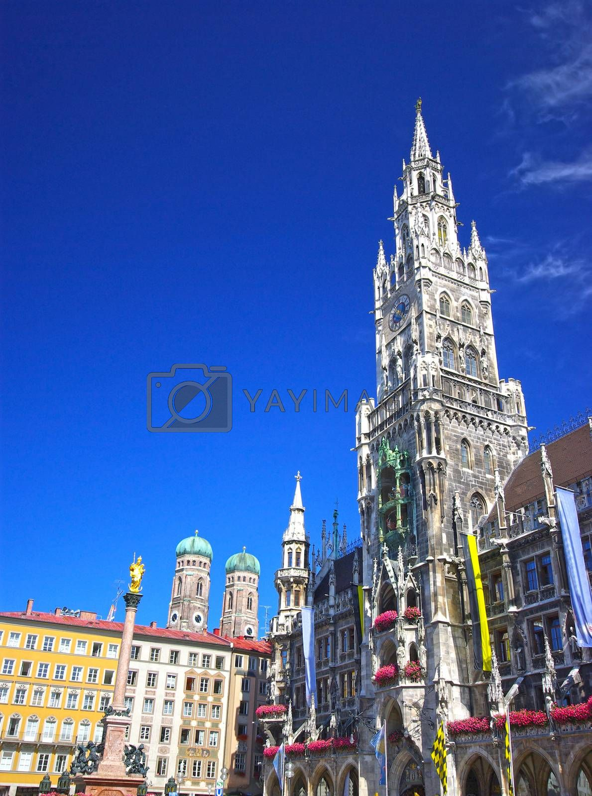 Square of medieval city (Marienplatz) with the monument and city hall in Munich.