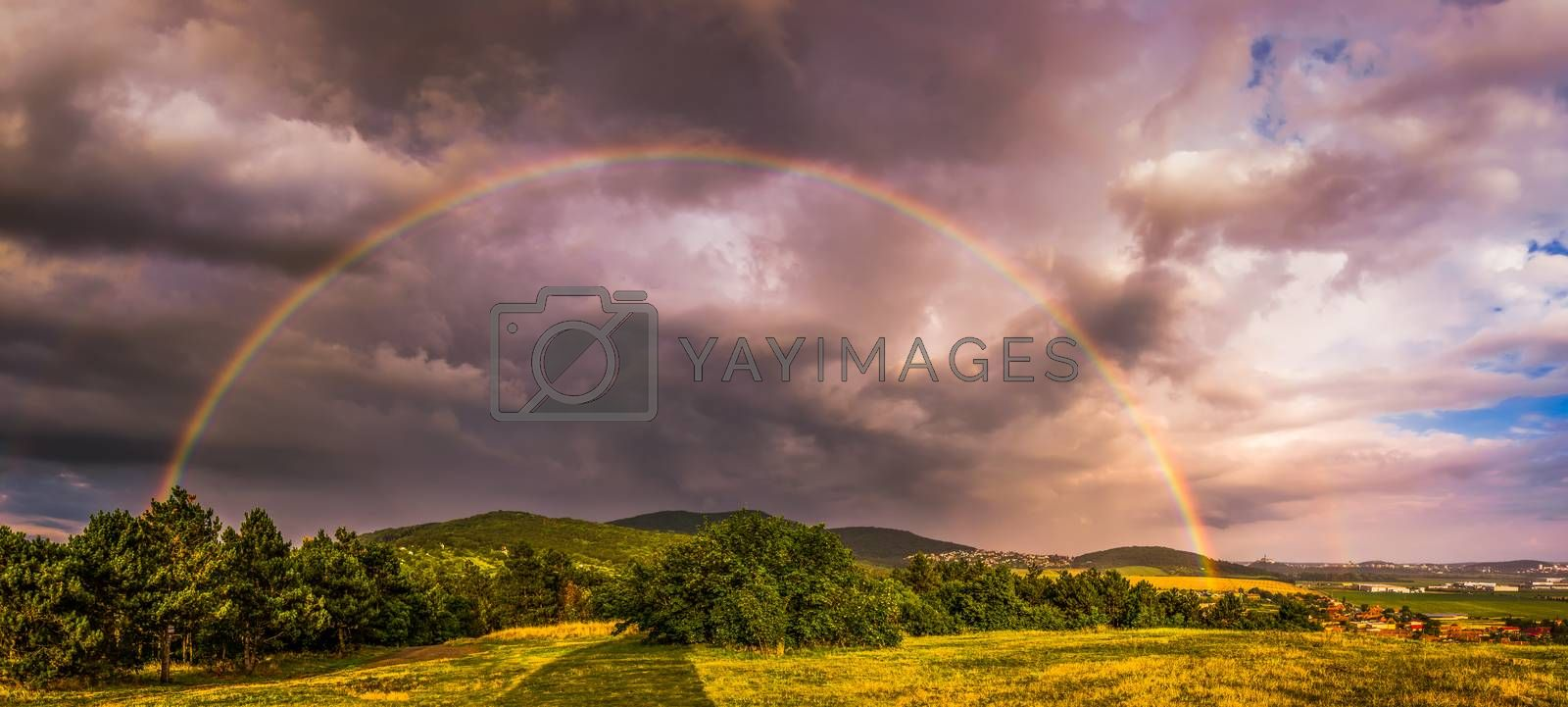 Rainbow over Landscape at Sunset with City of Nitra in Background
