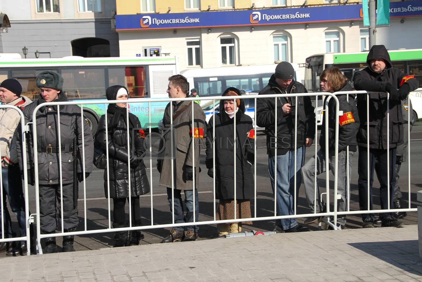 Vigilantes in the cordon around the opposition rally by olegkozyrev