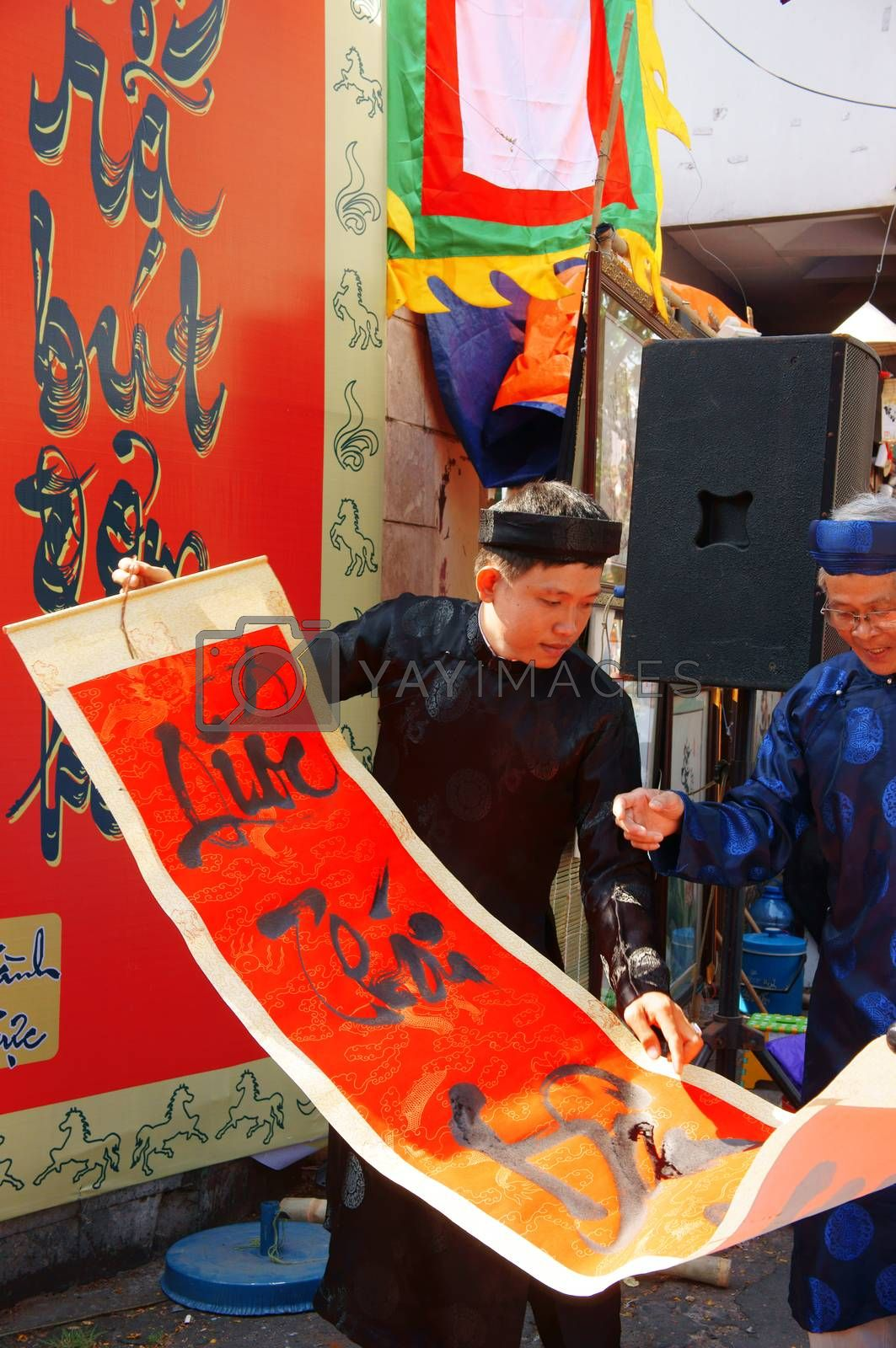 handwritting at traditional culture fair on Vietnamese Tet by xuanhuongho