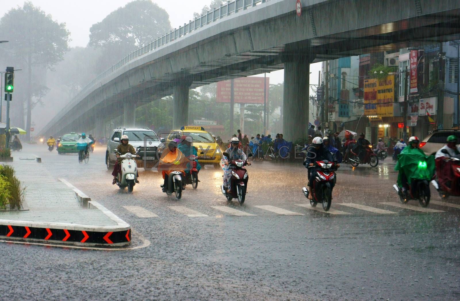 Traffic of Asia city in raining season by xuanhuongho