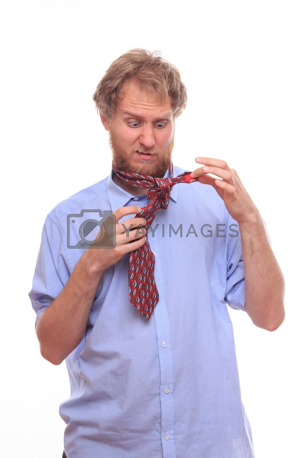 Man first time at morning tie a tie on his neck  by MichalLudwiczak