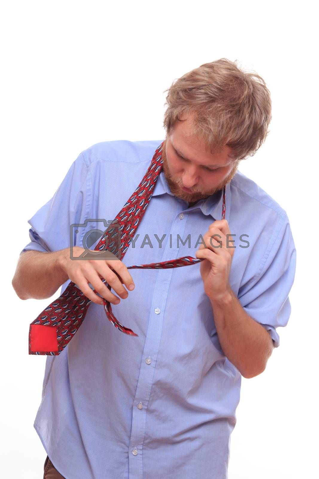 Man trying to bind a tie  by MichalLudwiczak