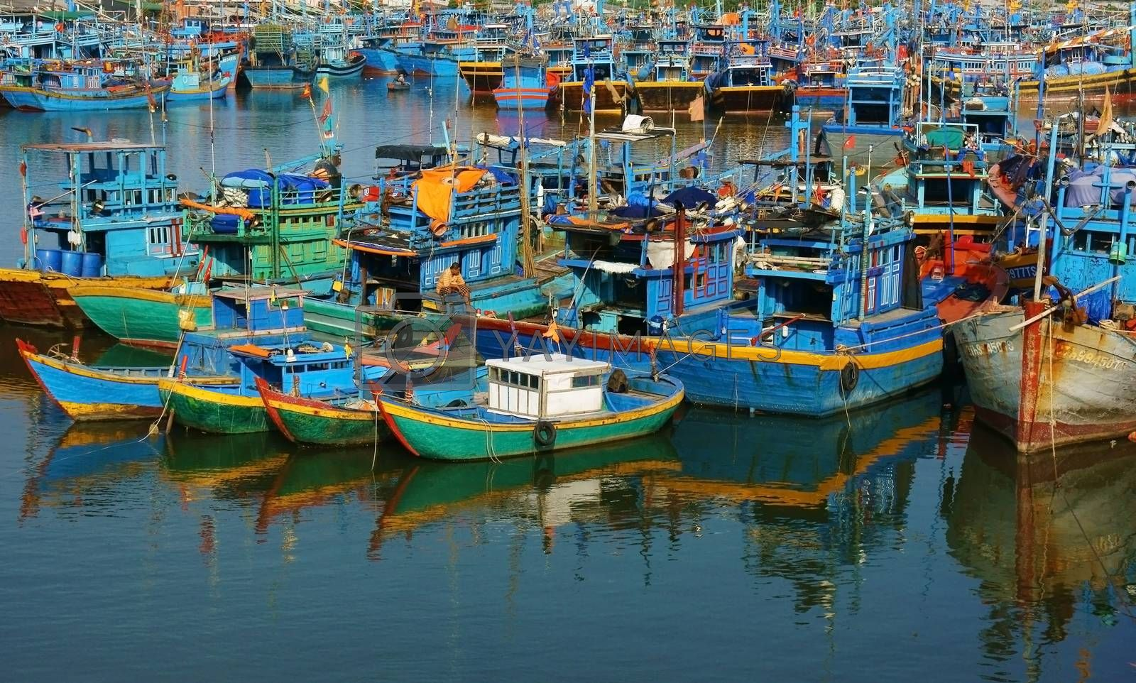 Group of fishing boat anchor at harbor by xuanhuongho