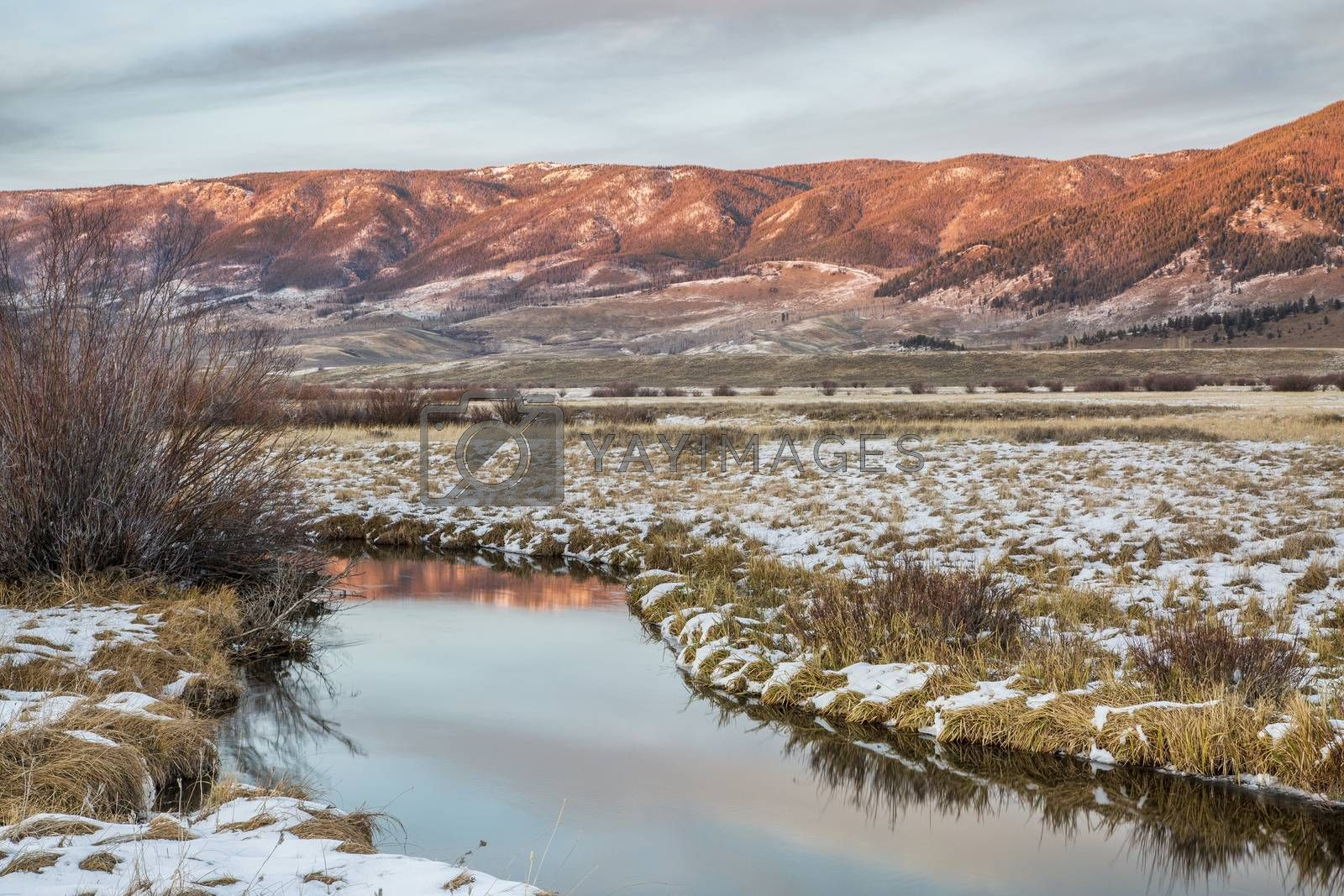 river and montains at dusk by PixelsAway