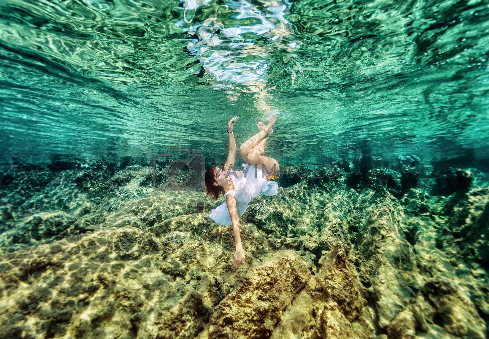 Fashion swimming underwater by Anna_Omelchenko