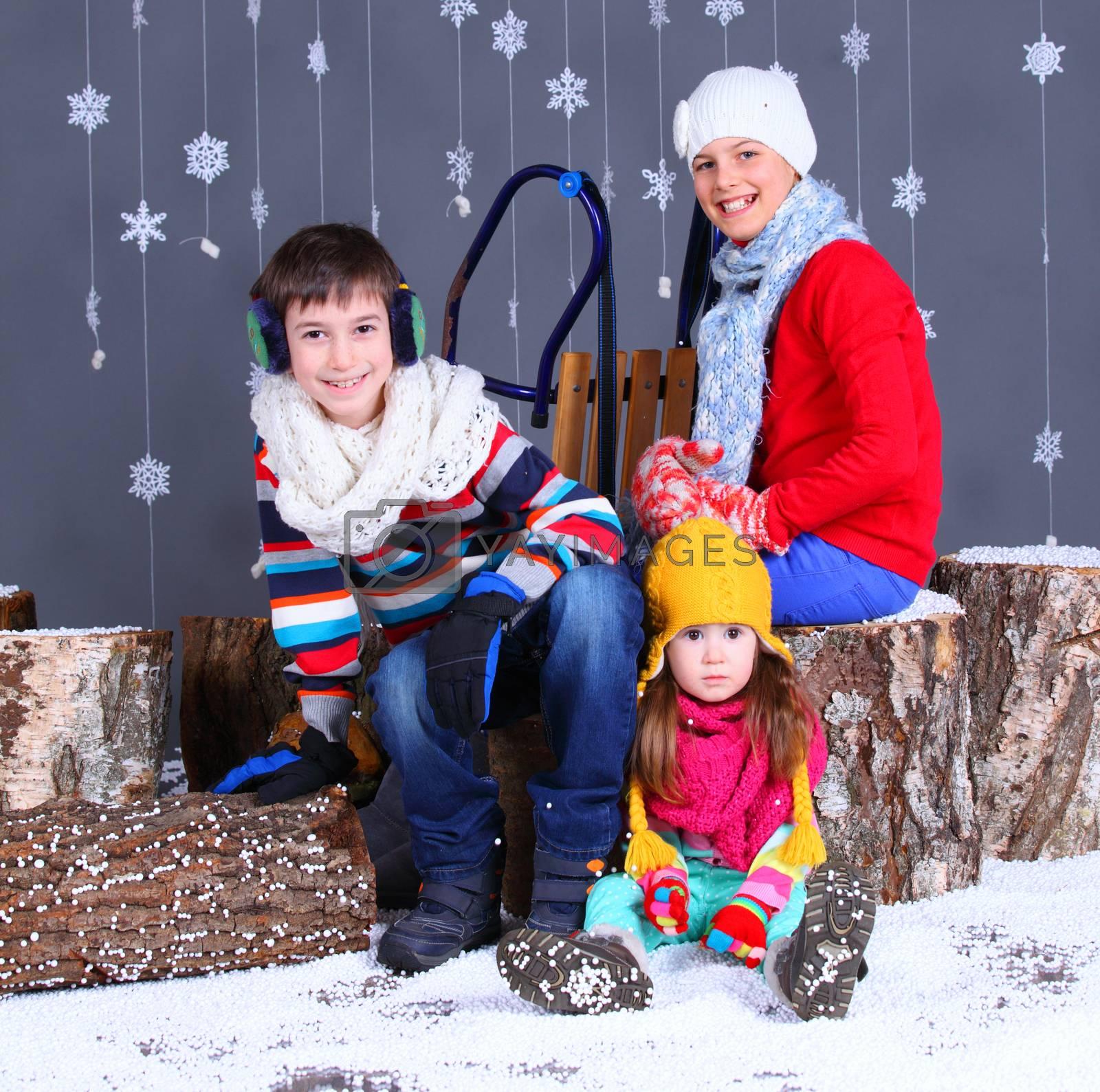 Winter Fashion. Adorable happy boy and girls. by maxoliki