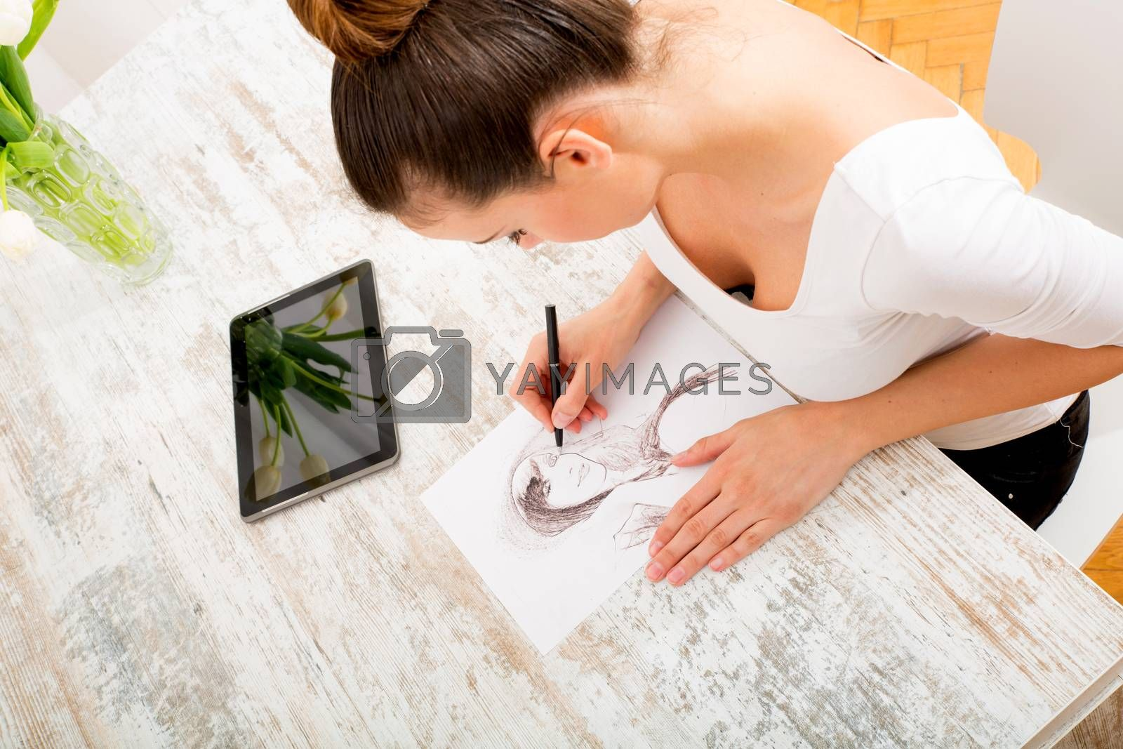 A young fashion designer working with a tablet pc.