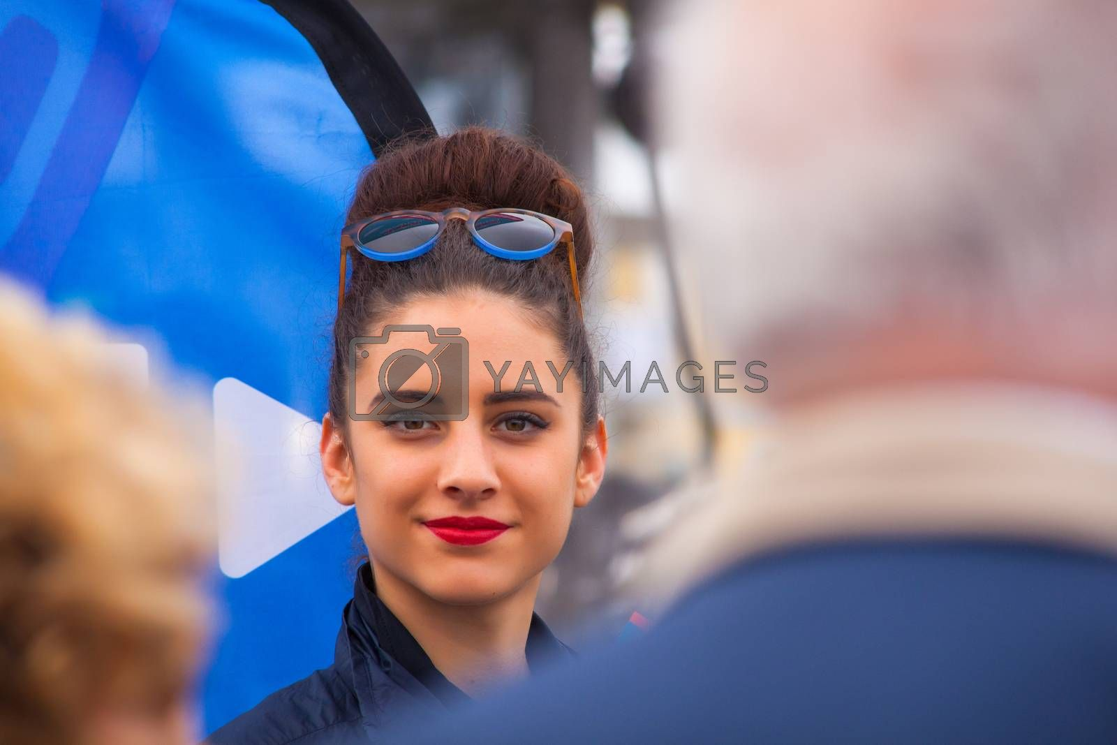 TRIESTE, ITALY - OCTOBER, 10: Beauty italian girl with glasses on head on October 10, 2014