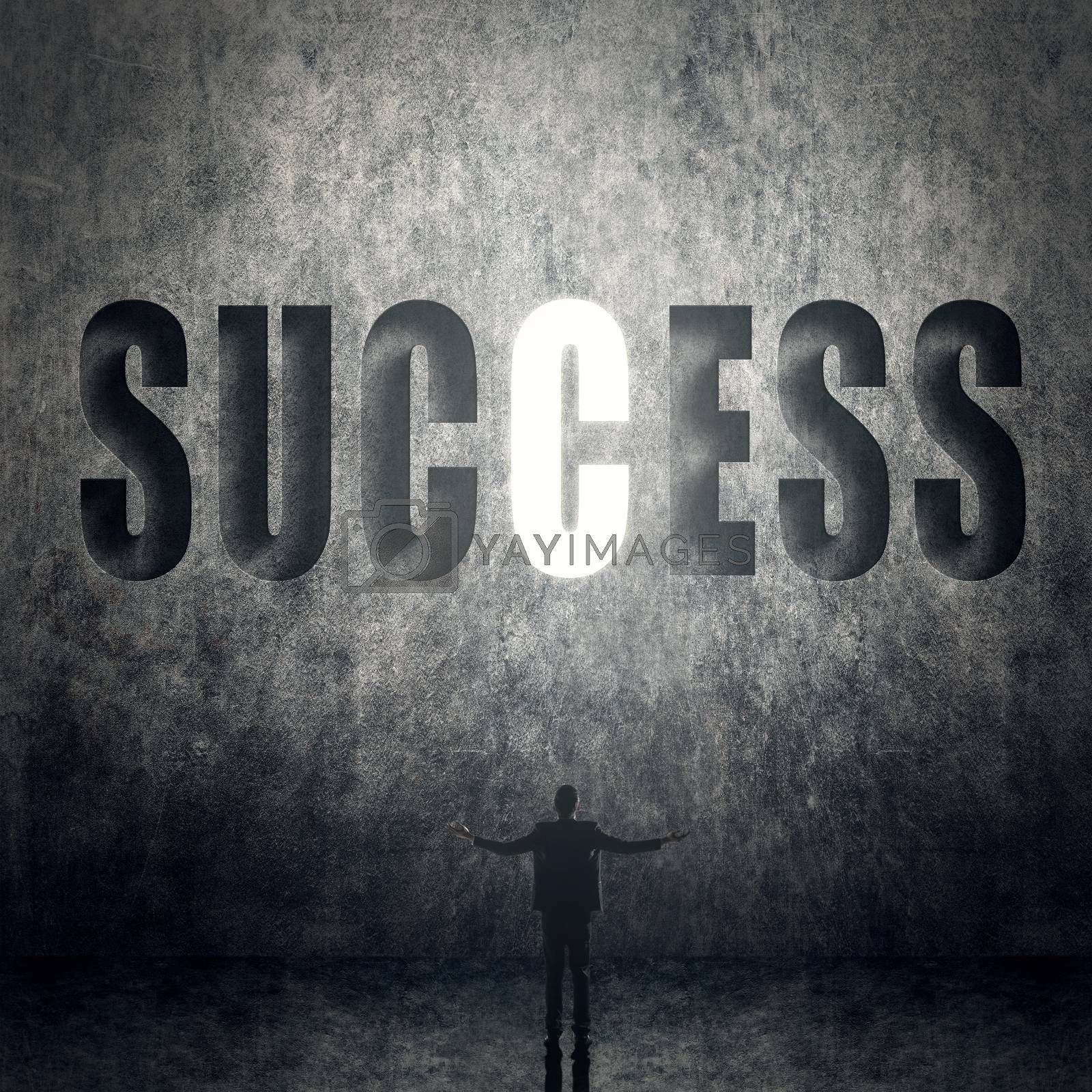 Concept of success, man stand on wall with text.