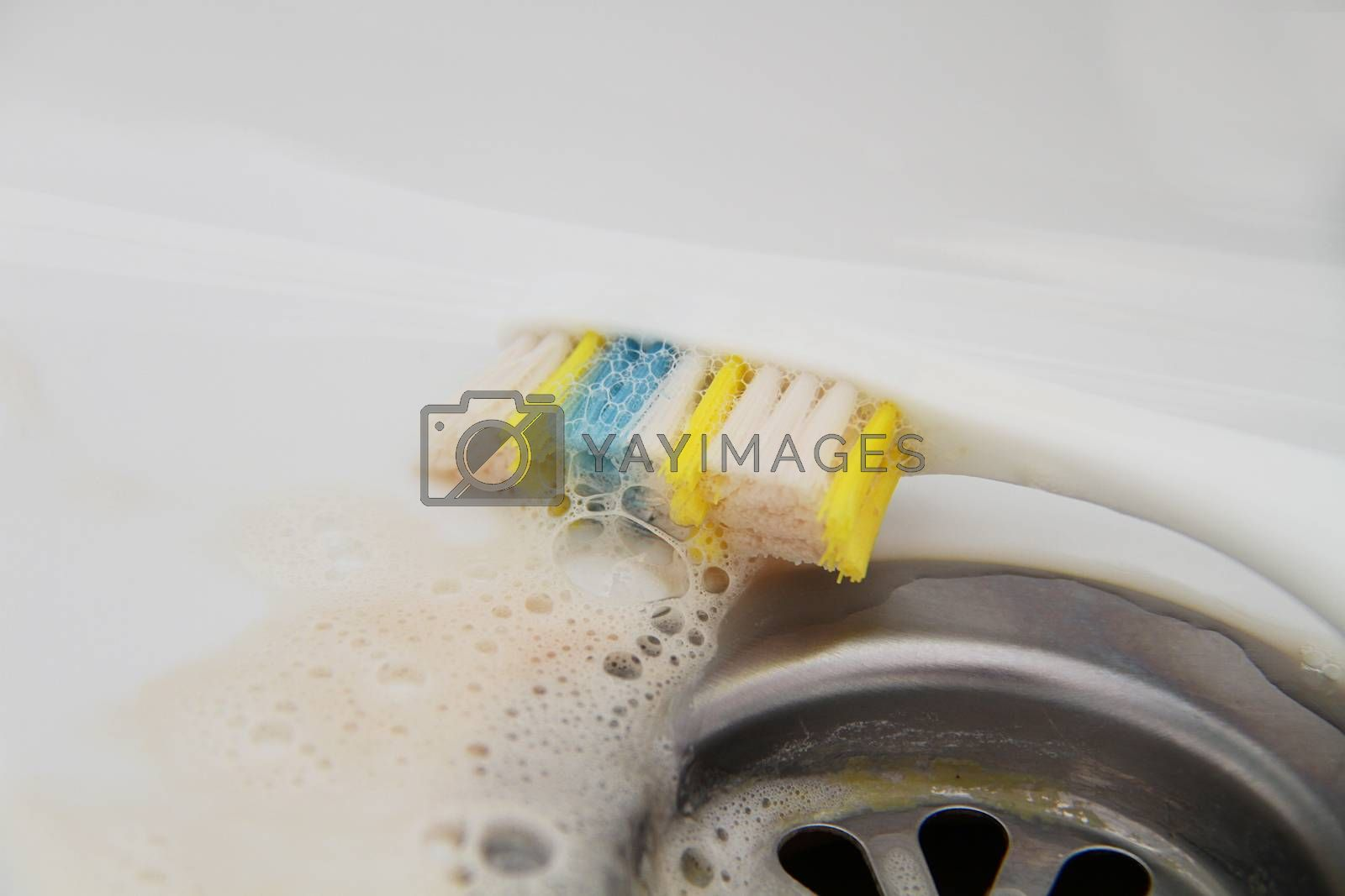 Blood and toothpaste on the toothbrush