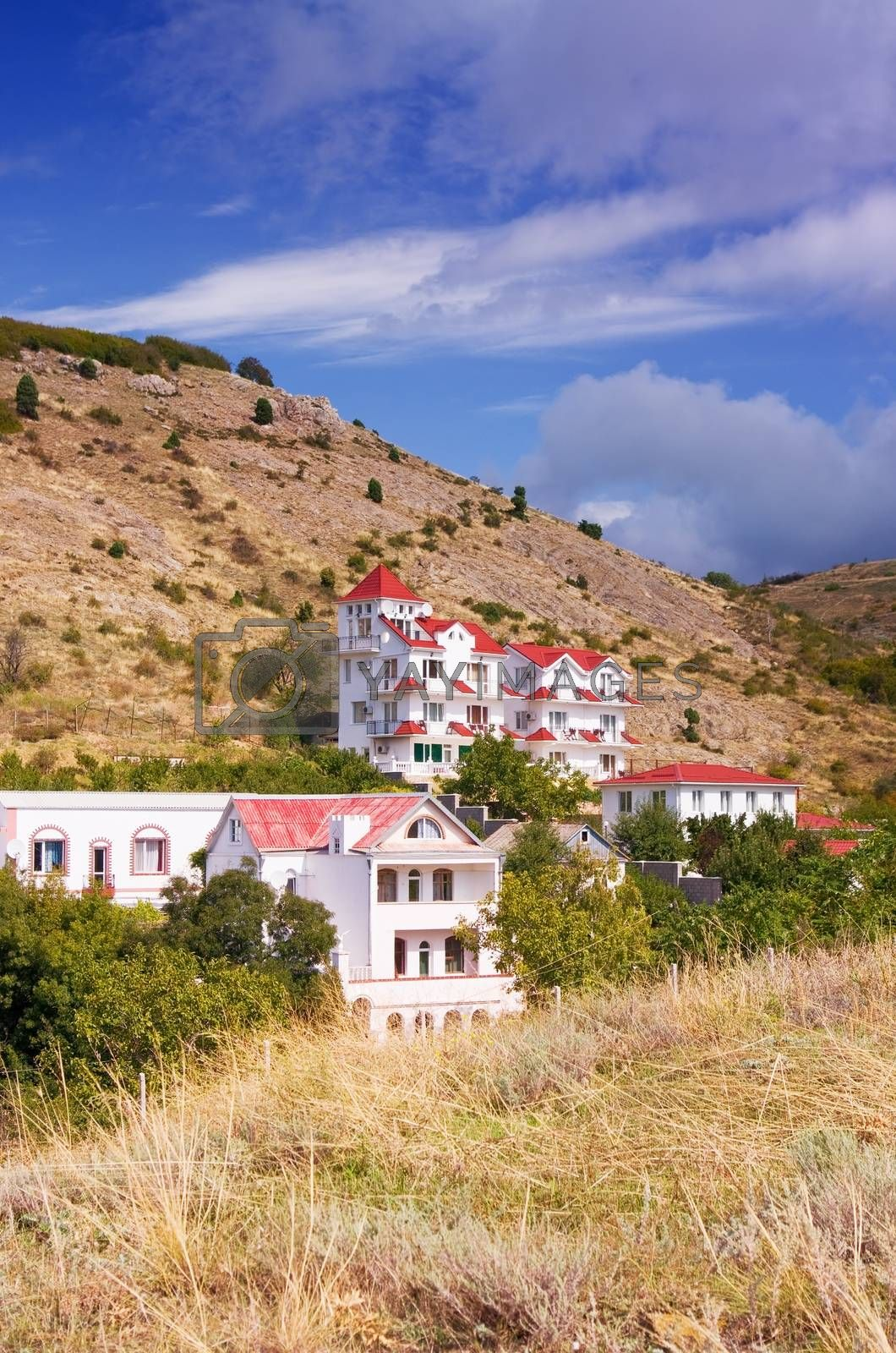 House with red roof on the hills
