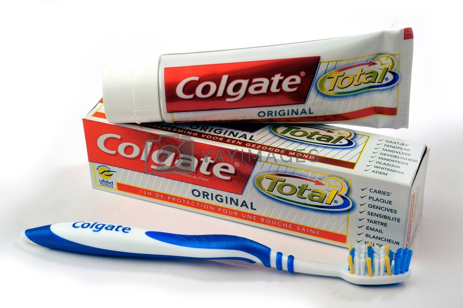 Set of Colgate toothpaste with toothbrush on white background