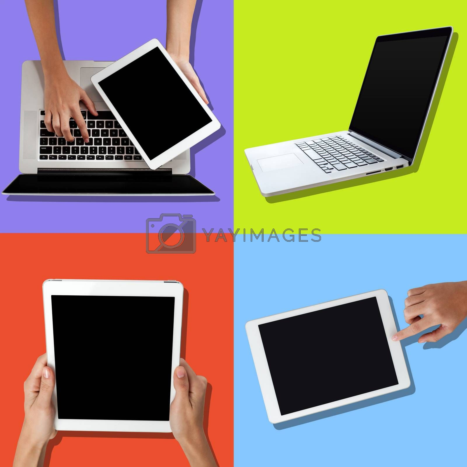 Human hand using laptop and holding tablet