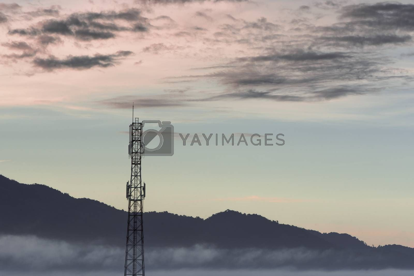 Telecommunication tower and sunset sky background