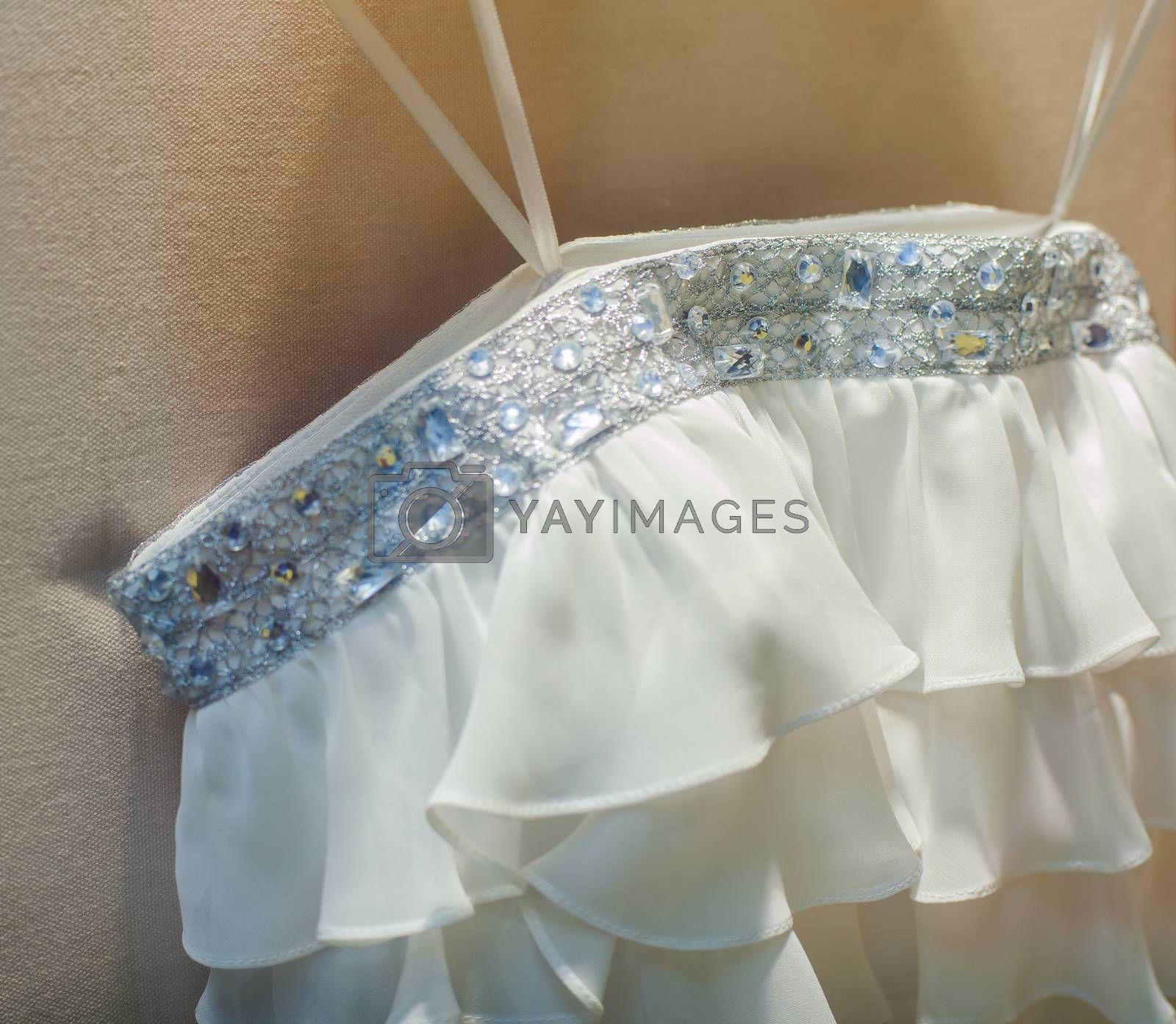 Close up of white wedding dress in the shop