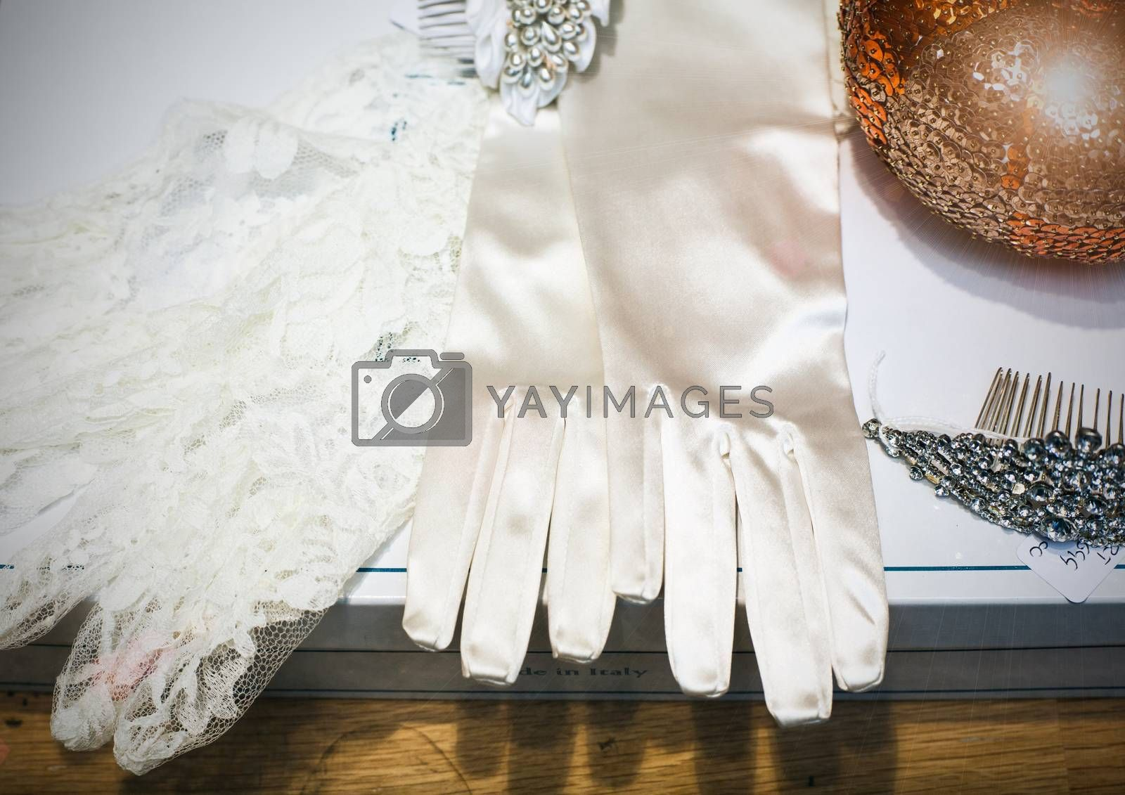 Close up of white wedding gloves in the shop