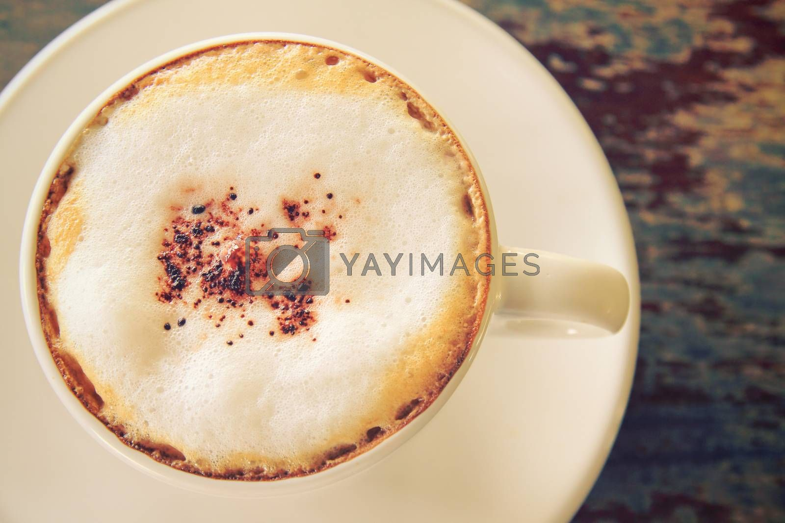 Cappuccino or latte coffee on table with retro filter effect
