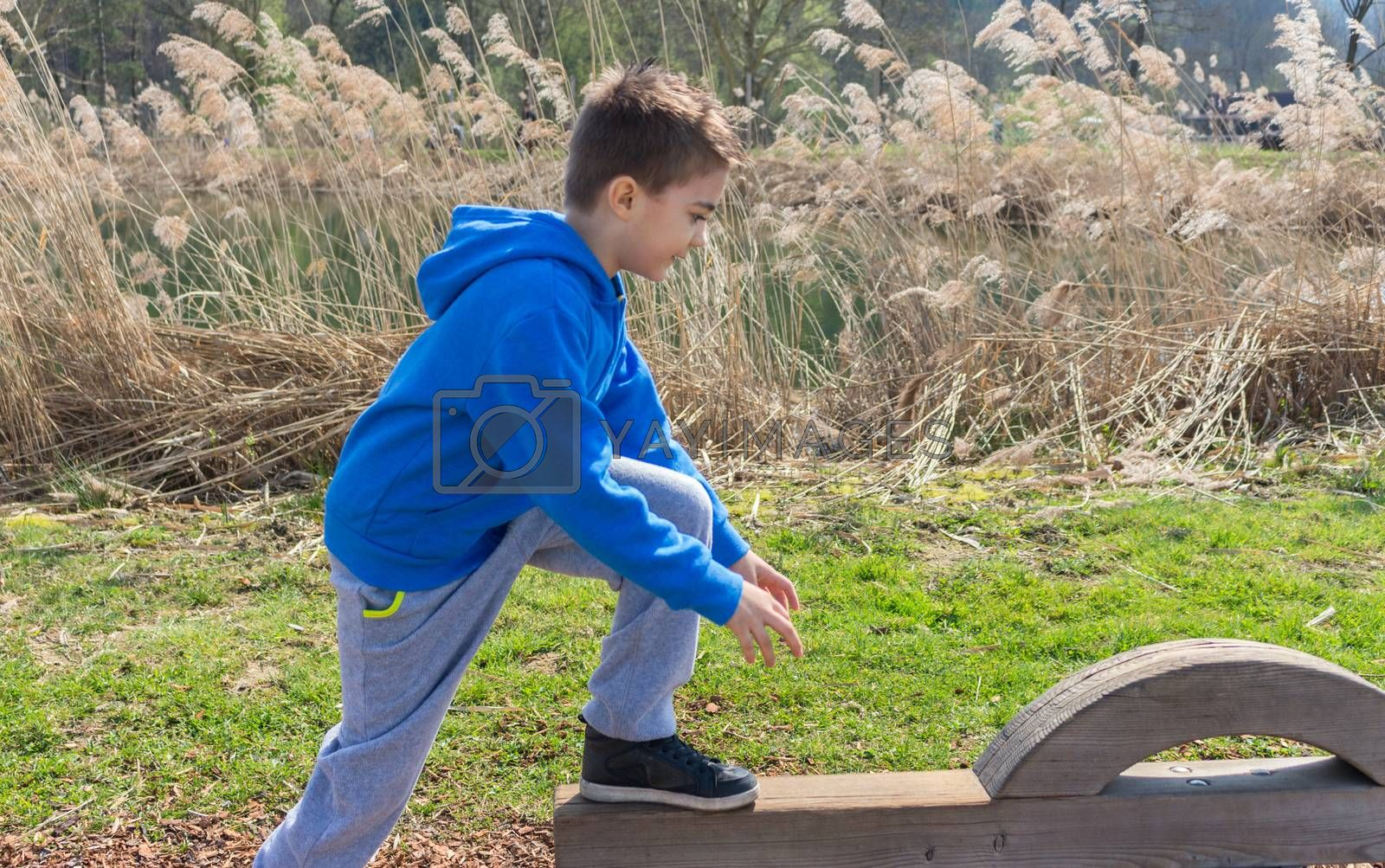 Young boy climbing on playground