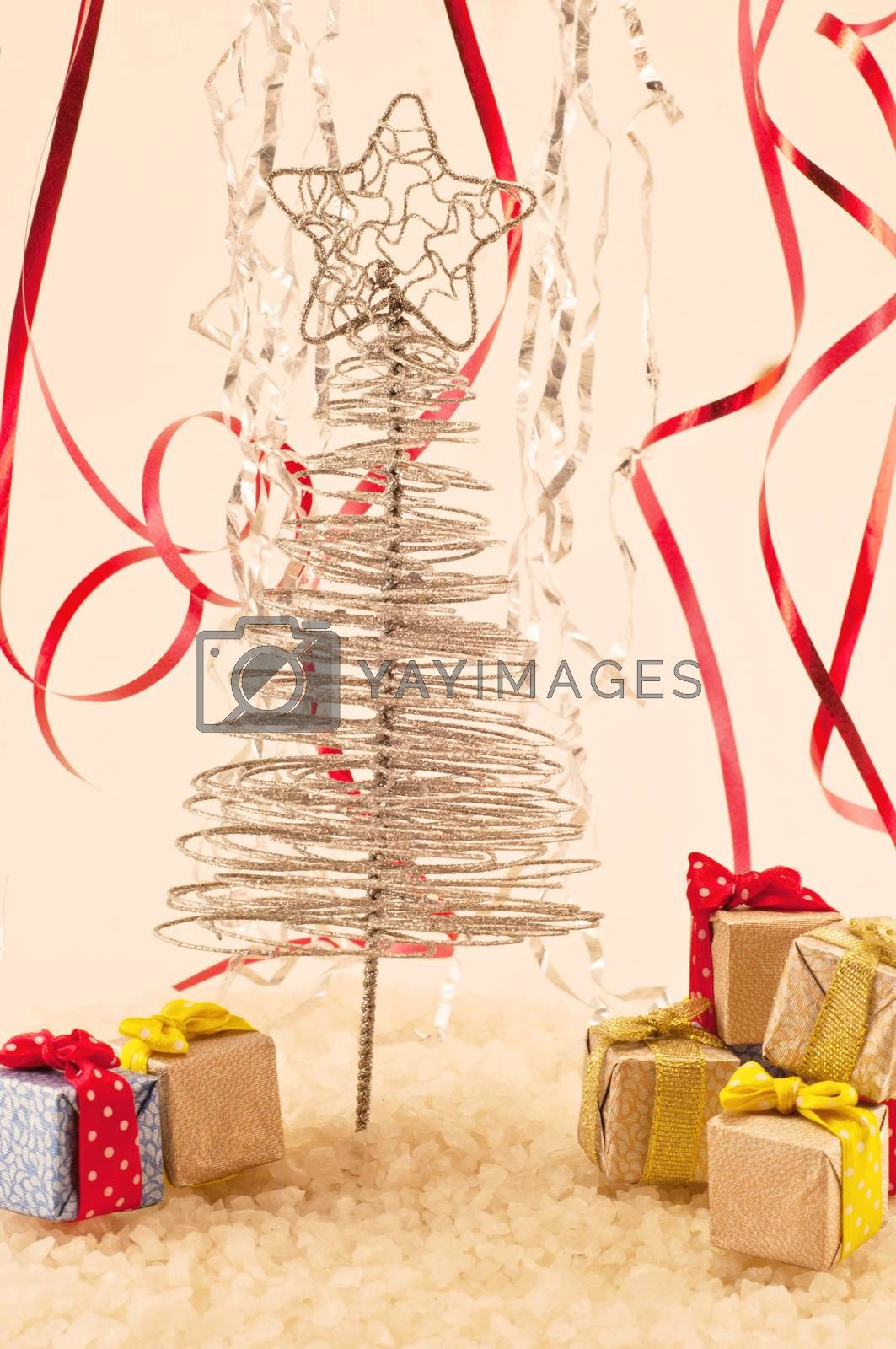 Christmas tree with presents on snow and colored fiefs