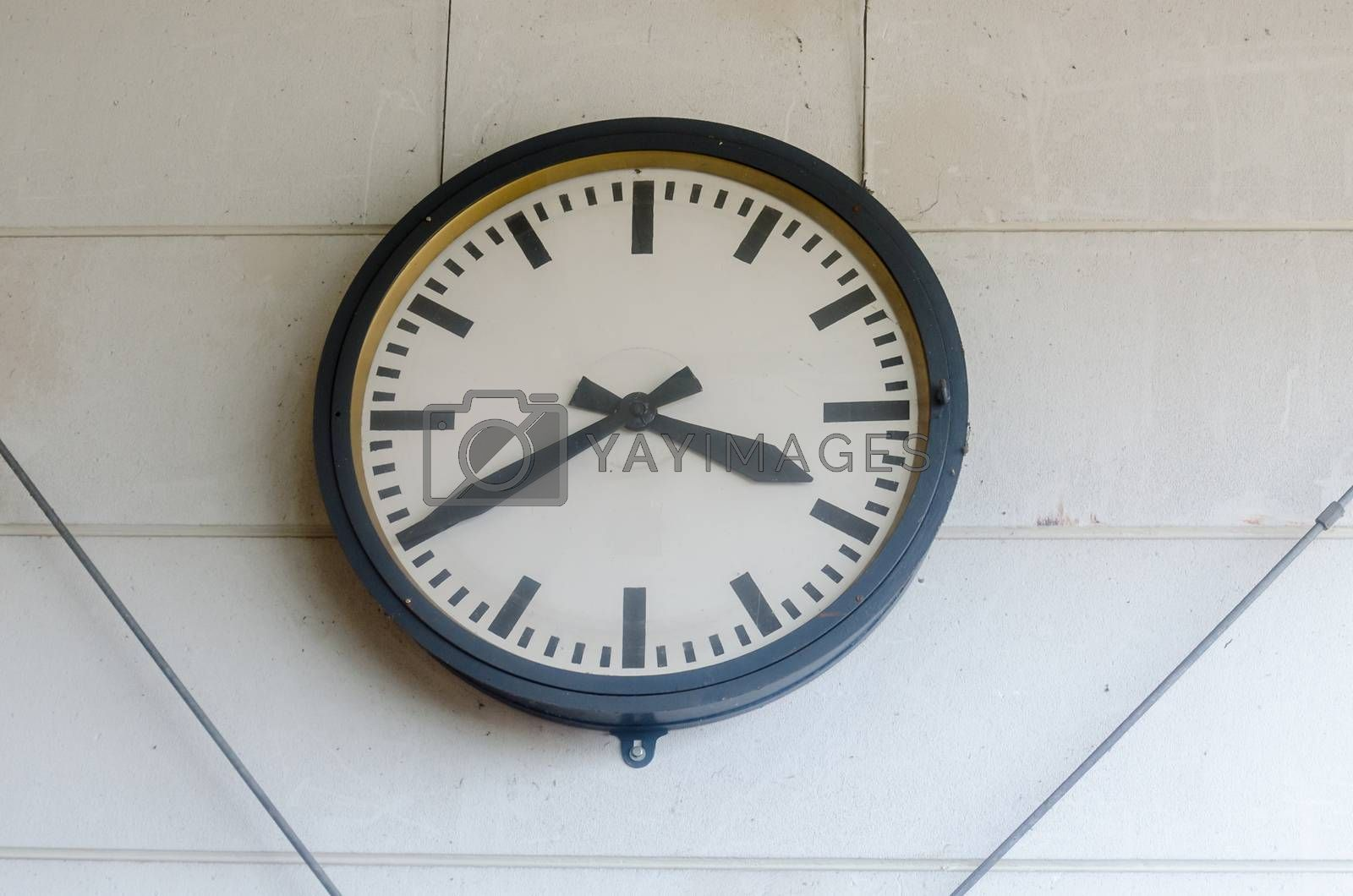 Normal Classic large wall clock in a factory.