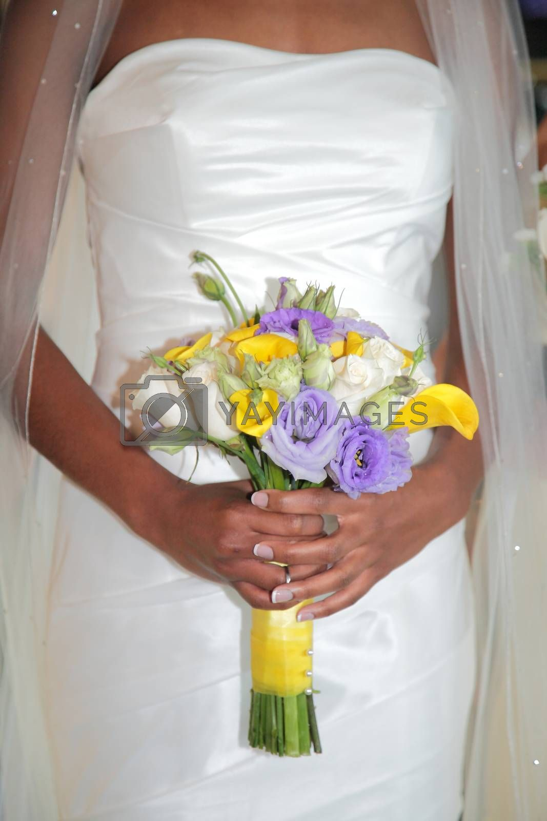 wedding ring in hand of bride and groom